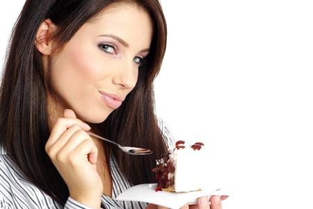 Woman eating cake Zdjęcie Seryjne