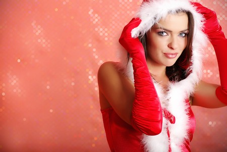 Portrait of beautiful sexy girl wearing santa claus clothes on red background Stock Photo - 7762525