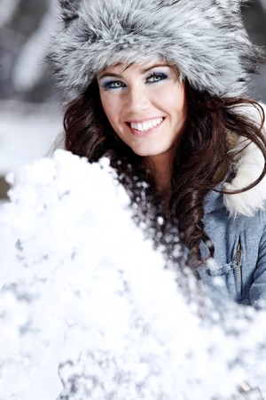 beautiful woman playing with snow photo