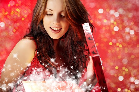 sexy girl smiles and holding a gift in magic packing Stock Photo - 7762618