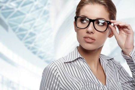 Portrait of pretty young business woman smiling Stock Photo - 7887173