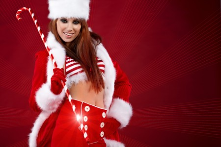 Portrait of beautiful sexy girl wearing santa claus clothes  Stock Photo - 7887224