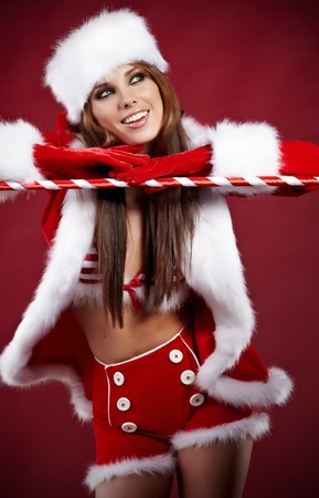 Portrait of beautiful sexy girl wearing santa claus clothes  Stock Photo - 7887226