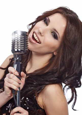 WOman singing in retro mic  photo
