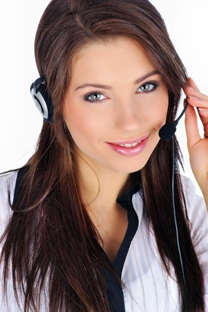 service center: Beautiful Customer Representative with headset smiling during a telephone conversation