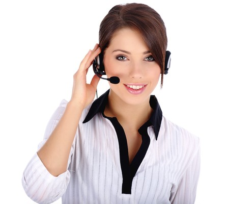 operator: Beautiful Customer Representative with headset smiling during a telephone conversation
