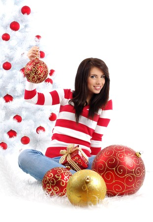 Beautiful girl with gift  next to white christmas tree Stock Photo - 7946350