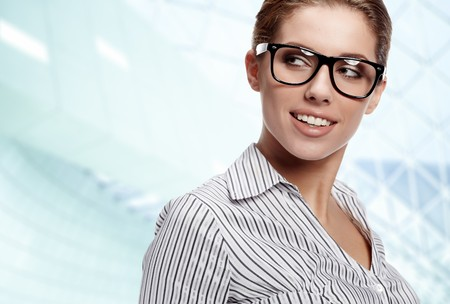 Young happy women or student on the business background Stock Photo - 7946506