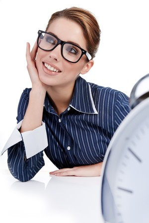 young businesswoman with a big clock  photo