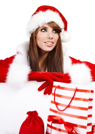 sexy christmas girl smiles and holding a gift in  packing  photo