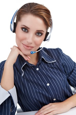 Customer Representative with headset smiling during a telephone conversation  photo