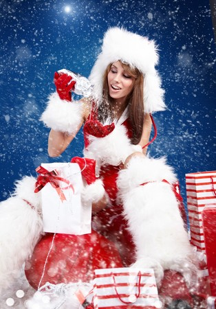 winter portrait of a santa  woman with a christmas gift Stock Photo - 8123395