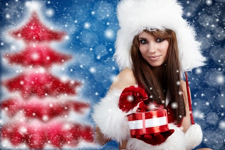 Portrait of beautiful sexy girl wearing santa claus clothes  Stock Photo - 8123323