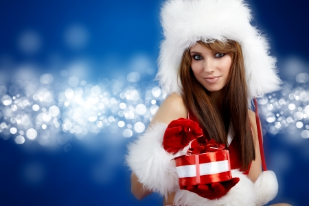 Portrait of beautiful sexy girl wearing santa claus clothes Stock Photo - 8124631