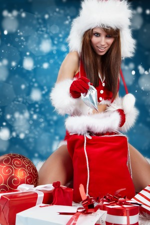 Portrait of beautiful sexy girl wearing santa claus clothes Stock Photo - 8123412