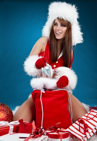 Portrait of beautiful sexy girl wearing santa claus clothes Stock Photo - 8123368