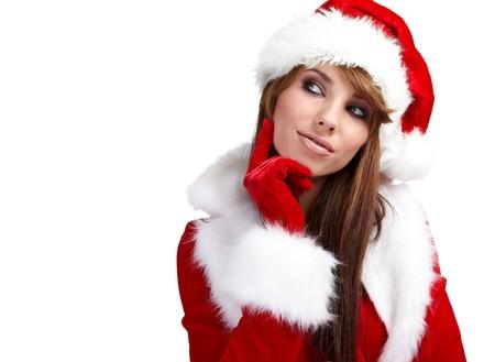 Beautiful young woman wearing santa hat  photo