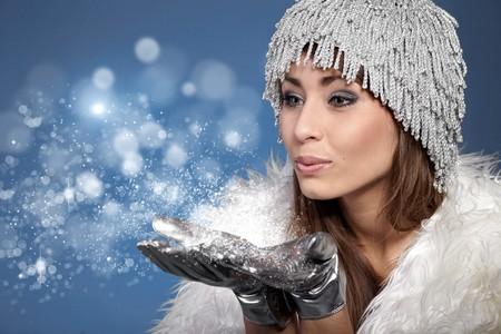 fur hood: Woman Blowing Snow