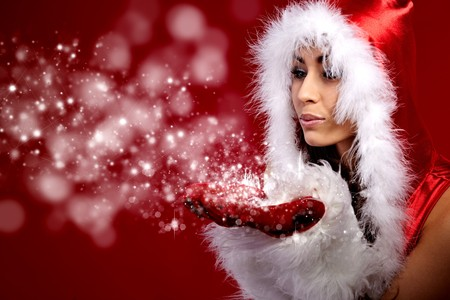 christmas costume: young christmas woman holding star over red background