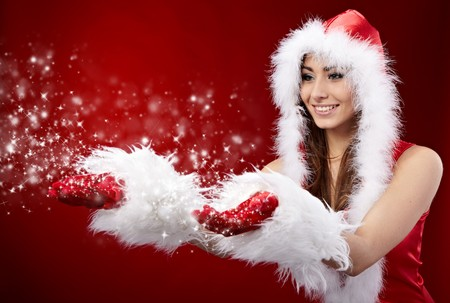 young christmas woman holding star over red background Stock Photo - 8195763