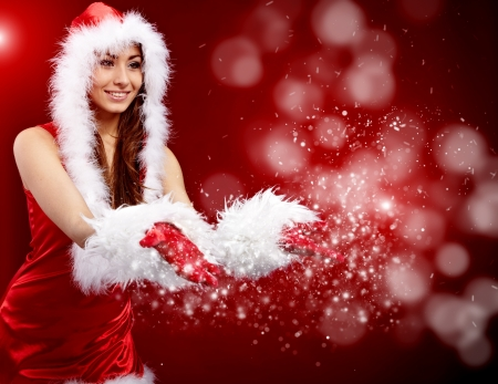 young christmas woman holding star over red background  photo