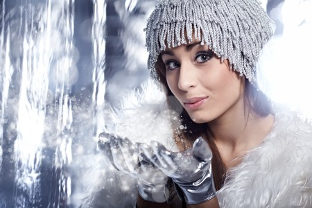 Woman Blowing Snow Stock Photo - 8195953