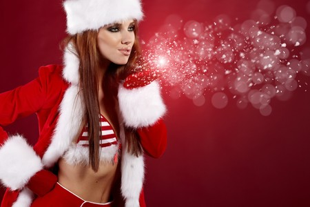 blow kiss: Photo of fashion Christmas girl blowing snow. Stock Photo