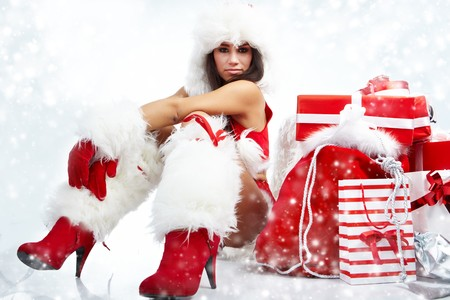 attractive young christmas women with the gift  photo
