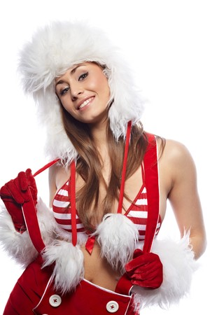 Beautiful Christmas woman in red santa hat holding Xmas decoration isolated on white  photo