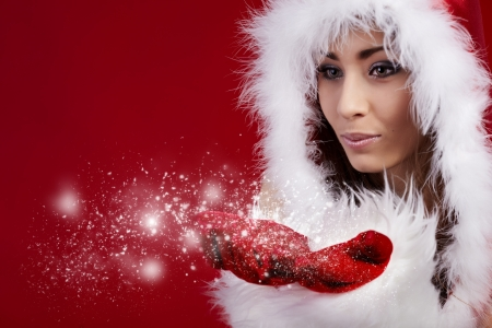 sexy santa girl: Photo of fashion Christmas girl blowing snow.