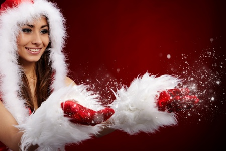 girl blowing: Photo of fashion Christmas girl blowing snow.