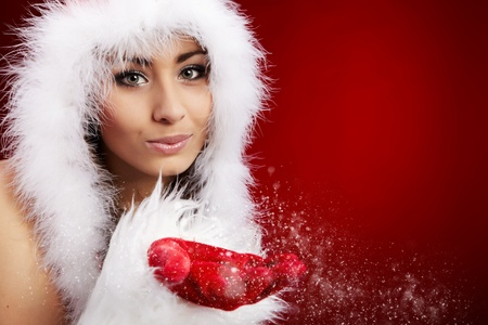 Photo of fashion Christmas girl blowing snow.  photo