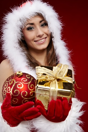 Young woman with Christmas present  photo