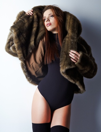 beautiful body woman in a fur coat photo