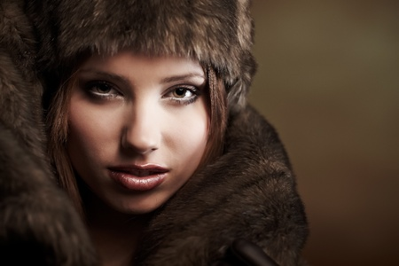 beautiful woman in a fur coat  Stock Photo - 8539674
