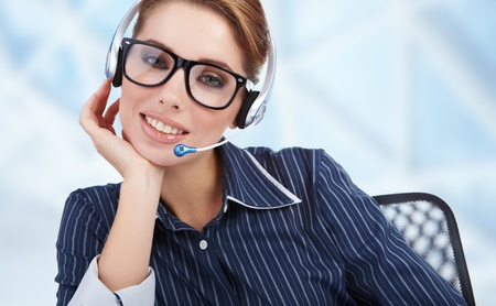 Support phone operator in headset at workplace Stock Photo - 8539639
