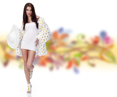 spring fashion: Spring woman dressed flower coat posing on white background