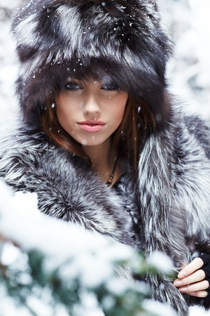 fur: Beautiful and sexy woman in snowy winter outdoors