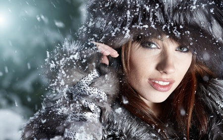 Image of beautiful female in luxurious fur head cloth looking at camera  photo