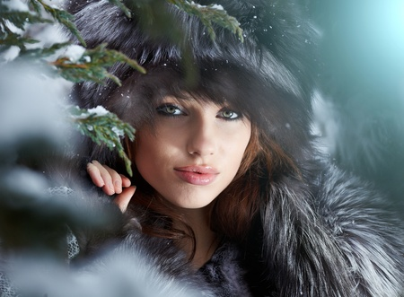 jungle girl: Beautiful young woman in winter forest  Stock Photo