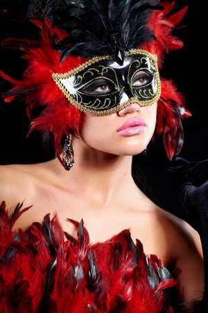 young sexy woman in violet party half mask. may be use for fashion makeup concept  photo