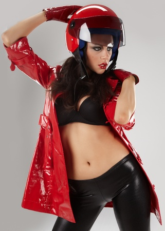 The beautiful girl with a motorcycle helmet Stock Photo - 8872743