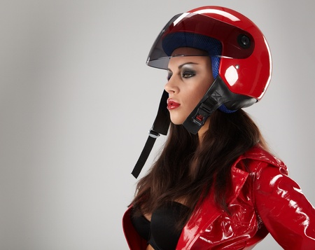 The beautiful girl with a motorcycle helmet Stock Photo - 8872741