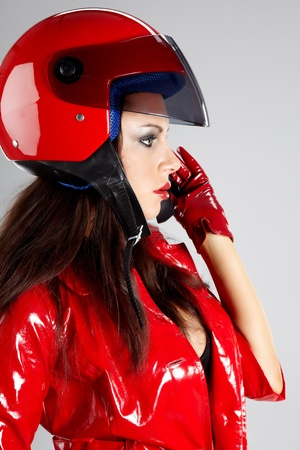 The beautiful girl with a motorcycle helmet Stock Photo - 8872730