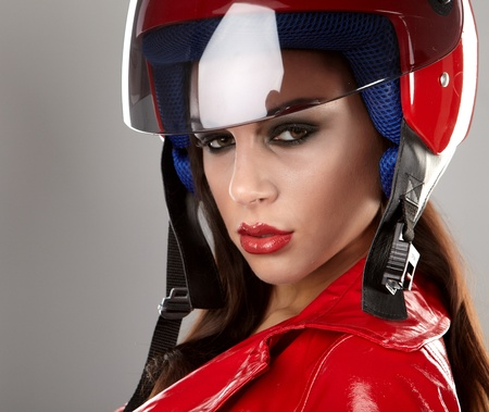The beautiful girl with a motorcycle helmet photo
