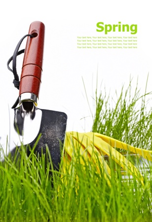 Assorted gardening supplies including watering can, pots, spade, shovel and cultivator on a white background  photo