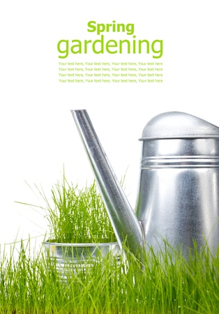 Watering can in grass with white background  photo
