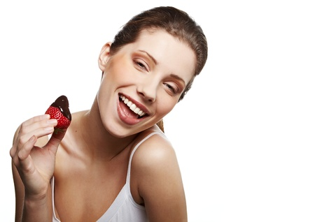 sexy tongue: Smiling woman with strawberry in chocolate