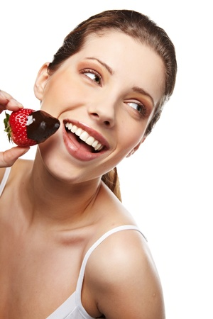Smiling woman with strawberry in chocolate photo