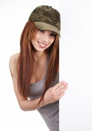 Beautiful woman holding empty white board Stock Photo - 9046505